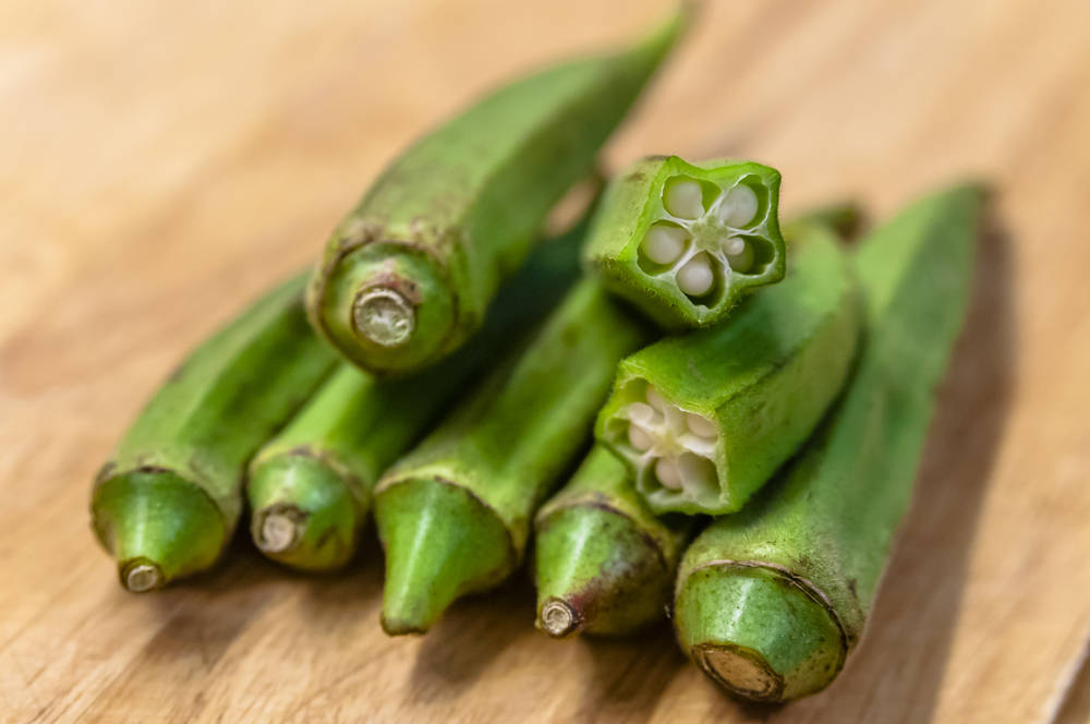 Fresh okra sitting on table