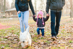 Family with Westie walking outdoors
